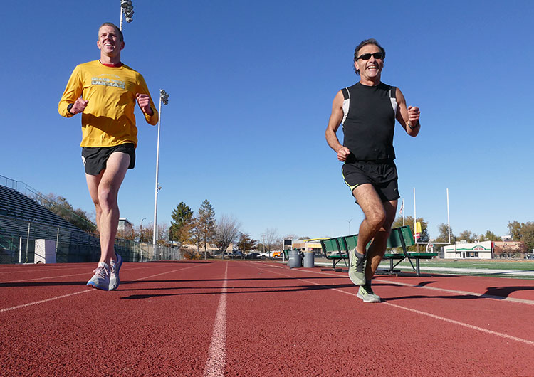 Runners of the Mesa Monument Striders running on the track of Stoker Stadium in Grand Junction, Colorado