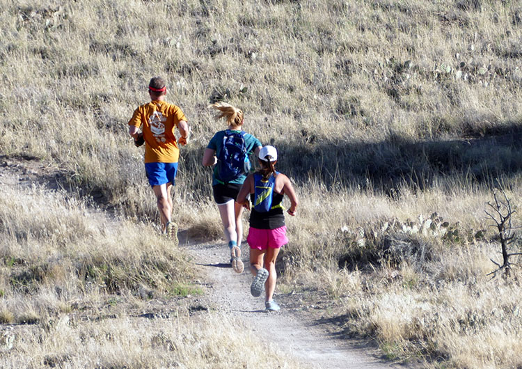 Runners of the Mesa Monument Striders running on the trails at Lunch Loop in Grand Junction, Colorado