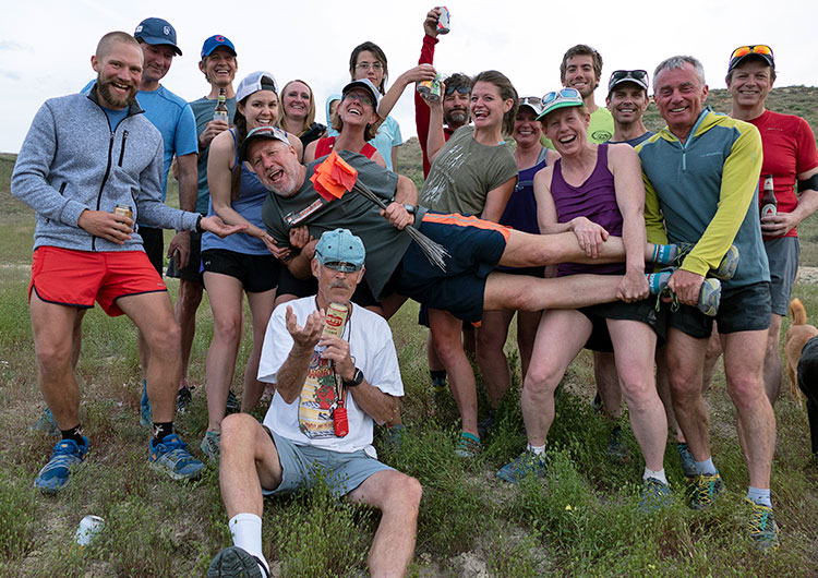 Runners of Mesa Monument Striders at the trailhead in Loma, Colorado