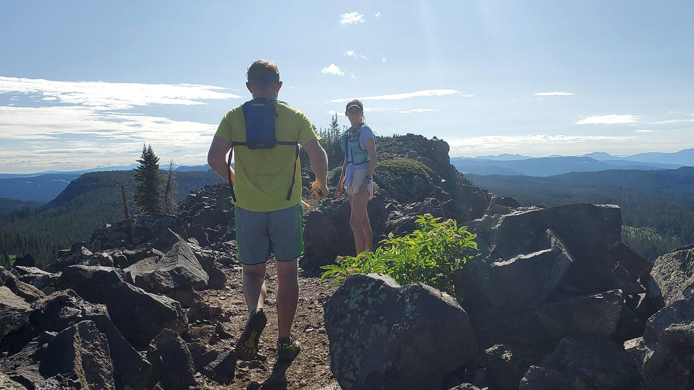Runners atop Crag Crest on Grand Mesa in western Colorado.