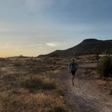 Runners on the trails in Loma, Colorado.